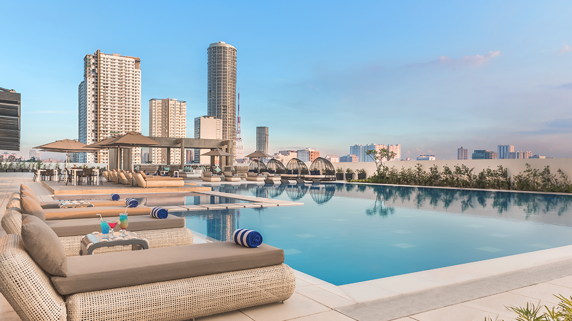 Swim at the Seda Vertis North rooftop pool